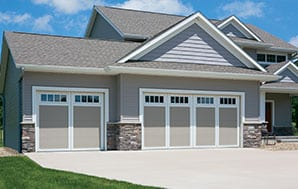home with double and single garage doors