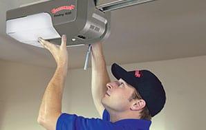 technician servicing a garage door