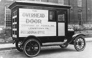 black and white photo of original Overhead Door truck