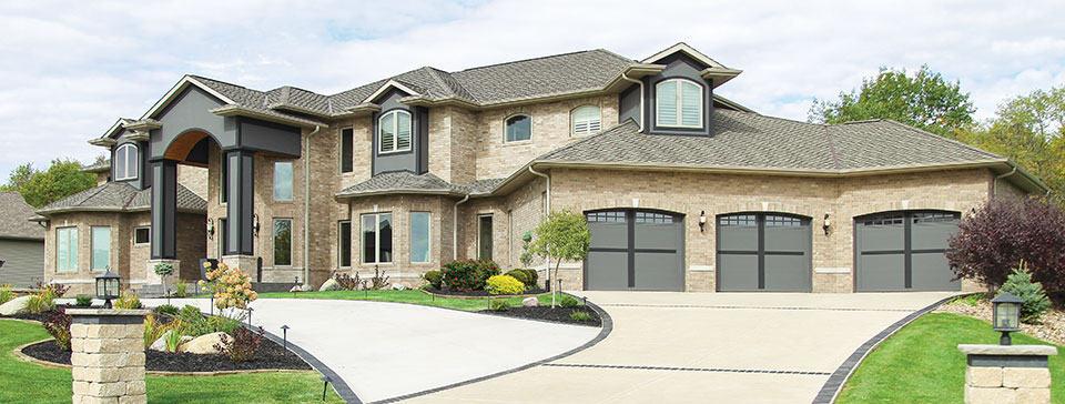 home with triple garage doors