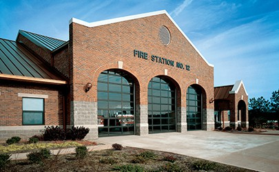 fire station with three glass overhead doors
