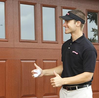 technician demonstrating new garage door