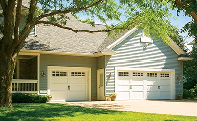home with single and double garage doors